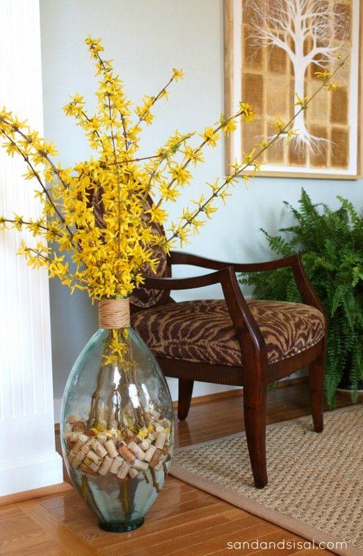 Forsythia arrangement with wine corks- + how to force forsythia indoors!  www.sandandsisal.com
