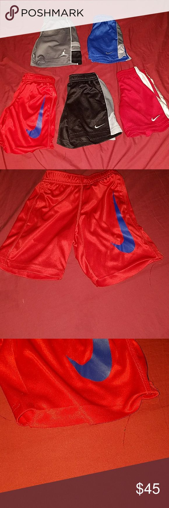 Bundle of 5 basketball style shorts 4 Nike shorts and 1 Jordan shorts. All look new except the red and blue nike shorts, the seam came apart at the end as shown in last pic. Nike Bottoms Casual