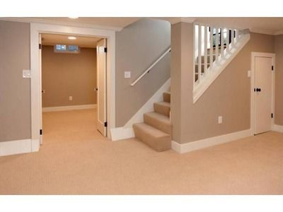 basement stairs - open railing wall, like how open it is at the bottom of the stairs.