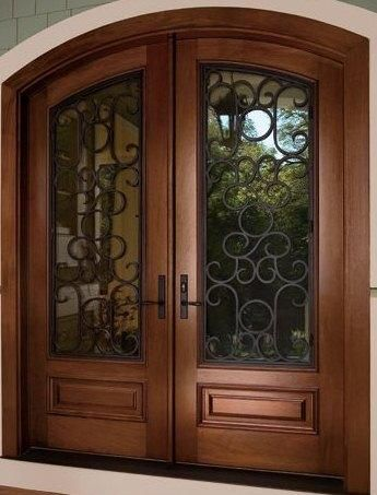 Solid wood double front doors with glass and wrought iron. Arched door top. front for. glass. wrought iron. iron.