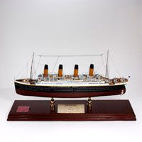 If you are a collector don't miss this large scale model ship with case, authentic coal and certificate signed by Titanic passenger, Millvina Dean! #CollectorsShip #Titanic