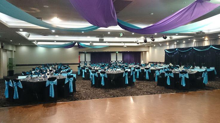 Purple and blue ceiling draping and blue chair ties. #bluewedding #wow #draping #beachwedding www.astylishcelebration.com.au