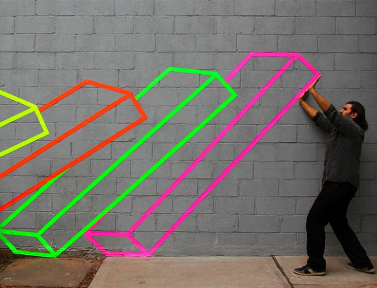 Brooklyn based street artist Aakash Nihalani uses brightly colored tape to create geometric pieces of art.