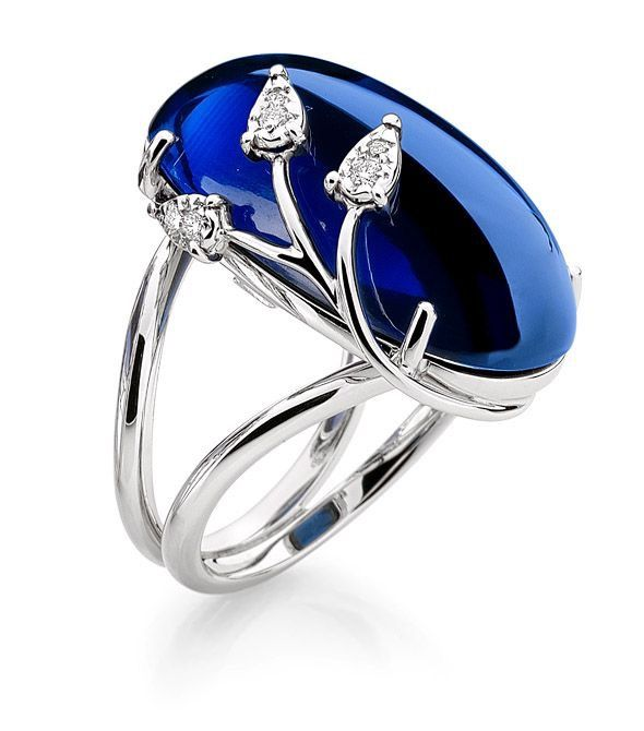 This cabochon sapphire is set in an 18K white gold mounting with round diamonds.  By Brumani.