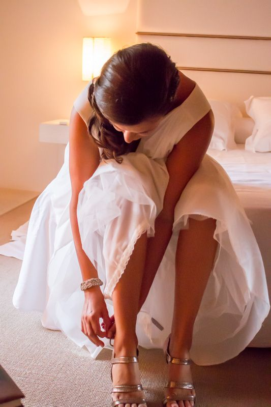 Putting on the wedding shoes. Photo: Ida Carr