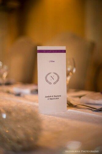 Purple wedding decor with an emblem I created