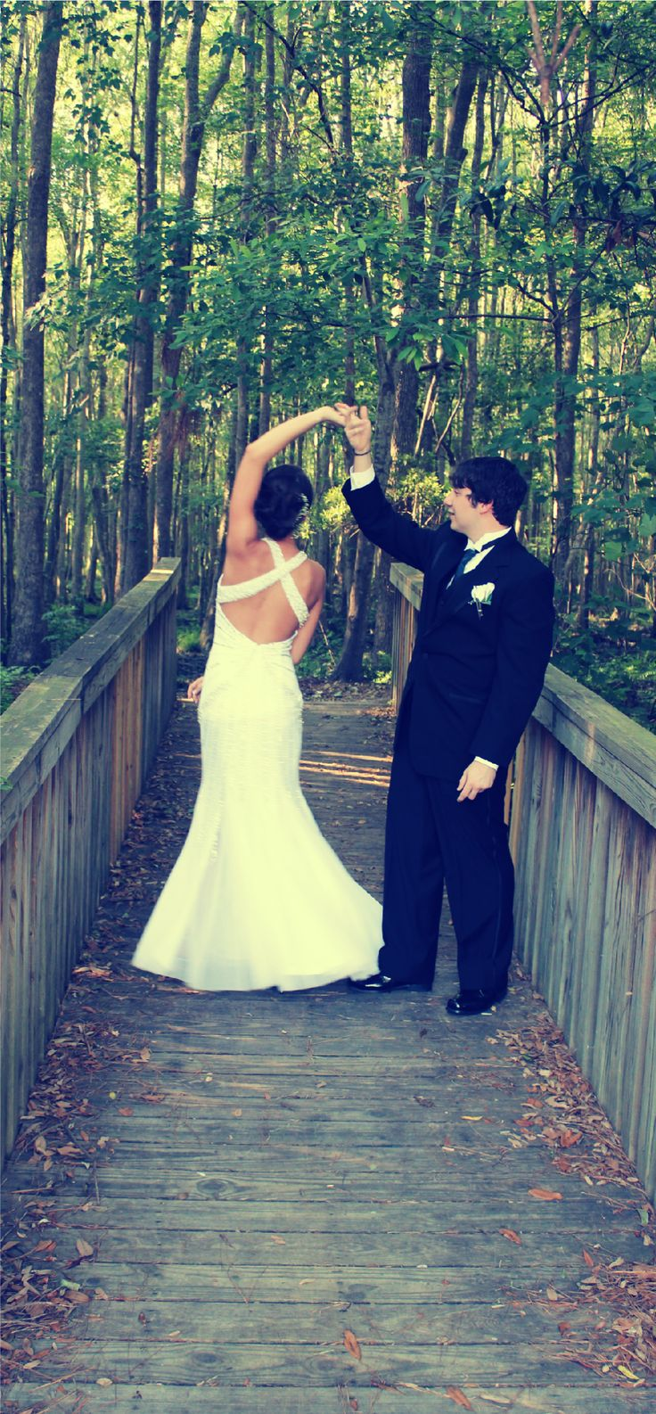 This may be a prom picture, but I love the idea for a wedding picture! So sweet!