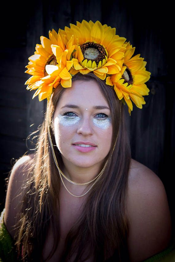This unique, sunshine sunflower floral crown, made from beautiful silk flowers is perfect for standing out from the crowd. Three beautiful large sunflowers are the centrepiece, with smaller sunflowers and yellow flowers to enhance. Finished with two layers of gold hanging chain. Made with a gripped hairband for comfort and ease, this item is perfect for making a statement and feeling fabulous. Ideal for costumes, festivals, or even the races!  All items are individual and one of a kind…