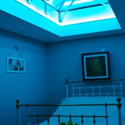 Looking to add colour to any room? We have a range of specialist LED lighting packages available. Here we have added blue lighting to a glass beam supported roof light