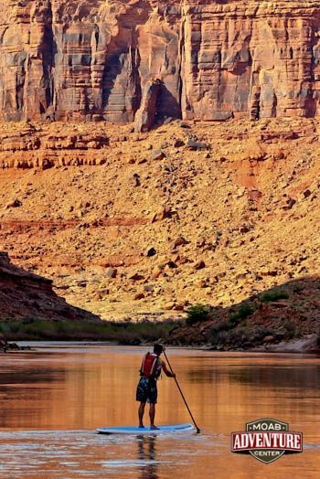 One of the most scenic and relaxing tours in Moab, stand-up paddleboarding (SUP) on the Colorado River with Moab Adventure Center #Utah #vacation #paddleboardtips