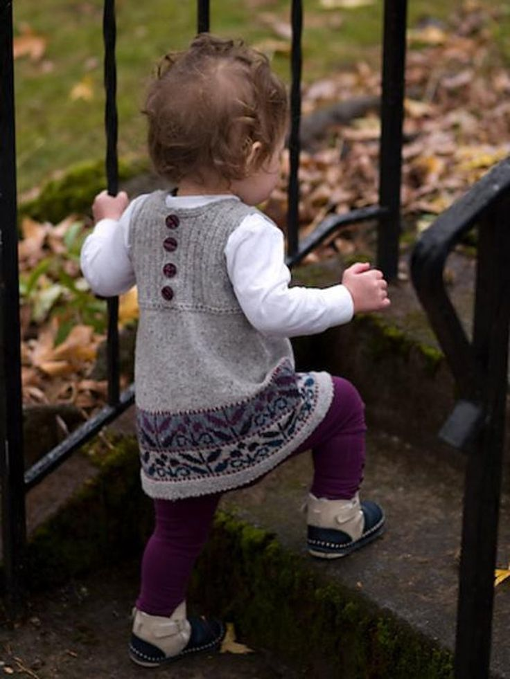 Winter Garden is a little girls' woolen jumper with a stranded colorwork motif to brighten the winter landscape. Worked at a fine gauge in a woolen-spun 2-ply wool, the jumper is light but warm, beautiful enough for festive occasions but not too precious for puddle stomping.