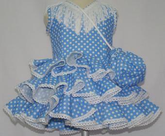 Traje de gitana flamenca para bebe en popelín turquesa con lunares blancos, adornado con punta de ojal blanco. Disponible bolsito y flecos a juego.