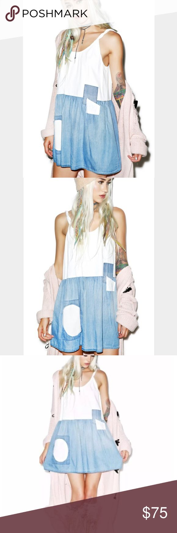 """WILDFOX CHAMBRAY PORT DRESS Denim Patch tank """"Wildfox Couture Chambray Port Dress yer gonna be ready for any adventure with this adorable sleeveless mini dress. With a roomy oversize fit perfect for layering, this fun bb has a super youthful feel. Featuring a gorgeous chambray skirt and vintage patch details, yer gonna look amazing."""" From dollskill - denim vintage patch twisted straps minidress tank. New with tags. Size large. Off white/ blue Wildfox Dresses Mini"""