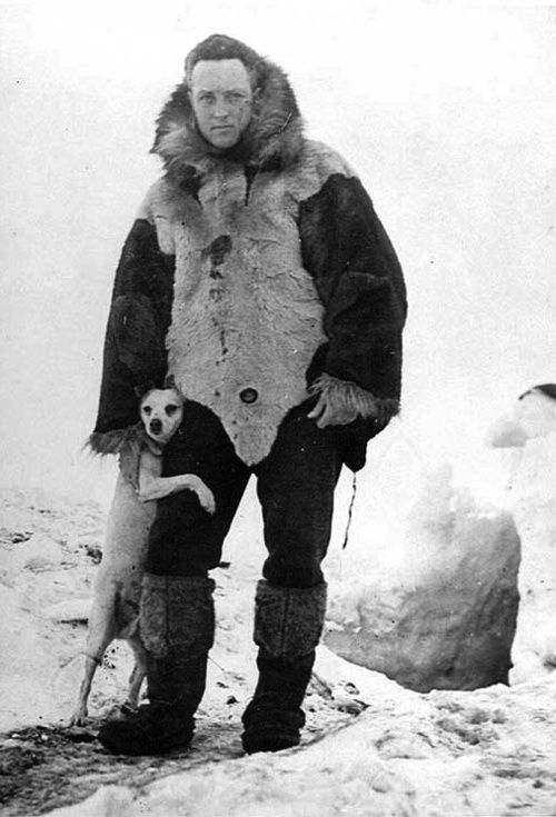 "<> Rear Admiral and explorer Richard Byrd and his dog ""Igloo"" during his 1930 expedition to Antarctica."