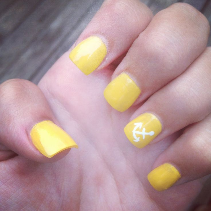 yellow nails with anchor design