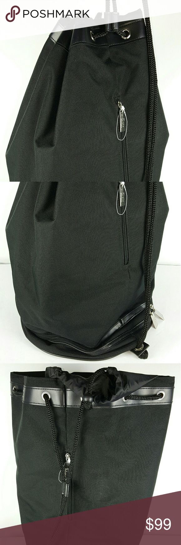 Cristian Dior perfums Large Nylon Travel Bag, New This Large Cristian Dior perfums Travel bag is New Without tags.  It has two compartments as seen in the pictures and a strung flap for maximum loads. Cristian Dior perfums  Bags Travel Bags