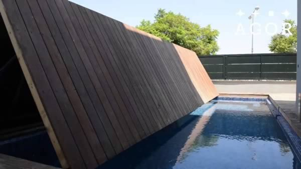 Folding wooden deck also works as a pool cover.    9 Coolest Hidden Pools - ODDEE