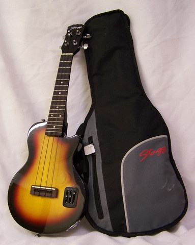 The Stagg Electric Ukulele features a solid maple body, a solid maple bolt-on neck, rosewood fingerboard & bridge, diecast nickel mini machine heads, a UK-2000 active onboard preamp with slider-style 2-band EQ & volume control, a headphone jack, an mp3 input and it also includes a gig bag.