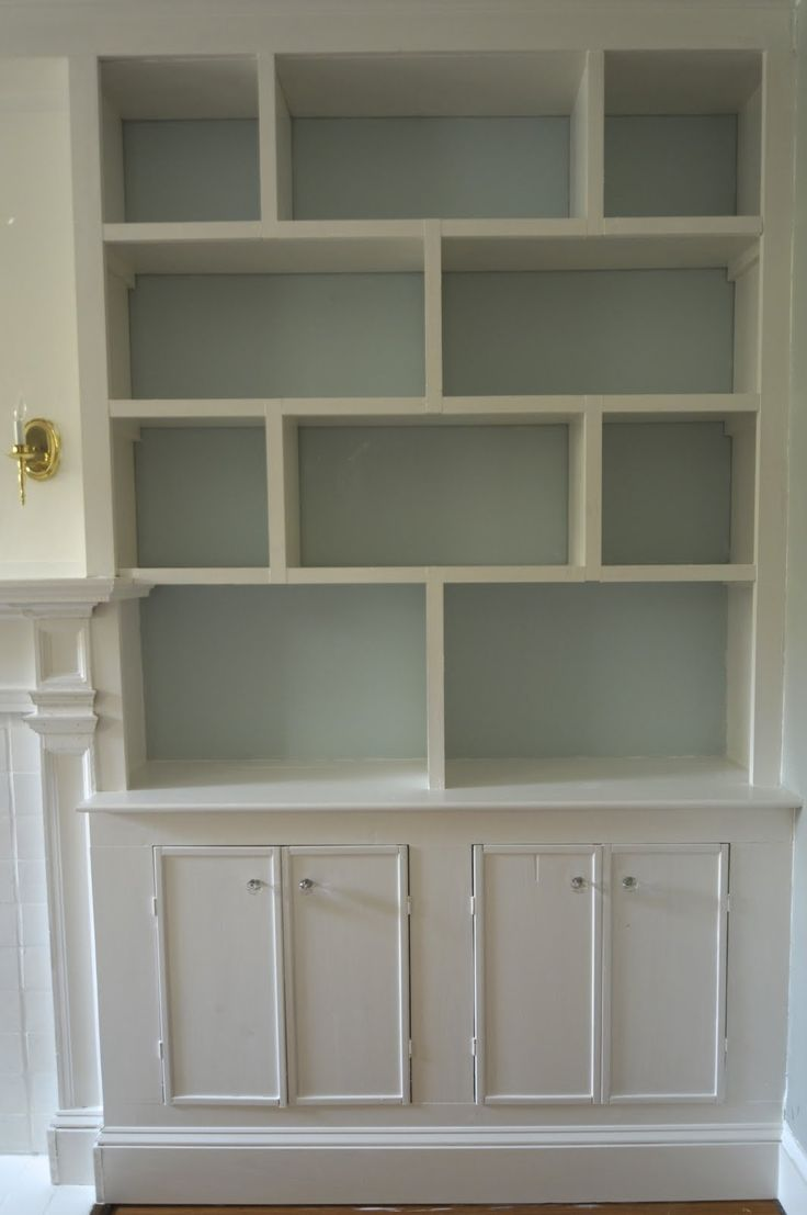 something like this in the living room~ I like the variety of sizes for the variety of books and knickety-knacks we have.