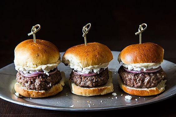 Lamb Sliders with Feta Cheese, Red Onions, and Cumin Mayonnaise recipe. The salty feta is the perfect accompaniment to the meaty lamb.