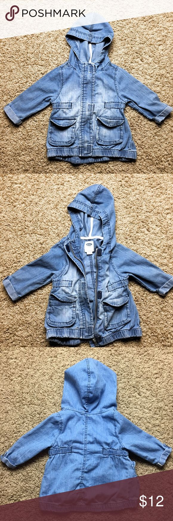 light weight hooded jean jacket Light weight hooded jean jacket. Zips and velcros.  Longer, with elastic sides to give it an adorable shape on your little one. Old Navy Jackets & Coats