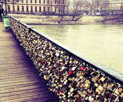 bridge love-locks. Buy a lock and lock it with a key then throw it in the river