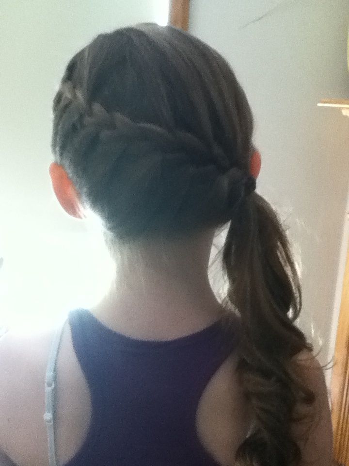 Side French braid into side ponytail, then curl unbraided ...
