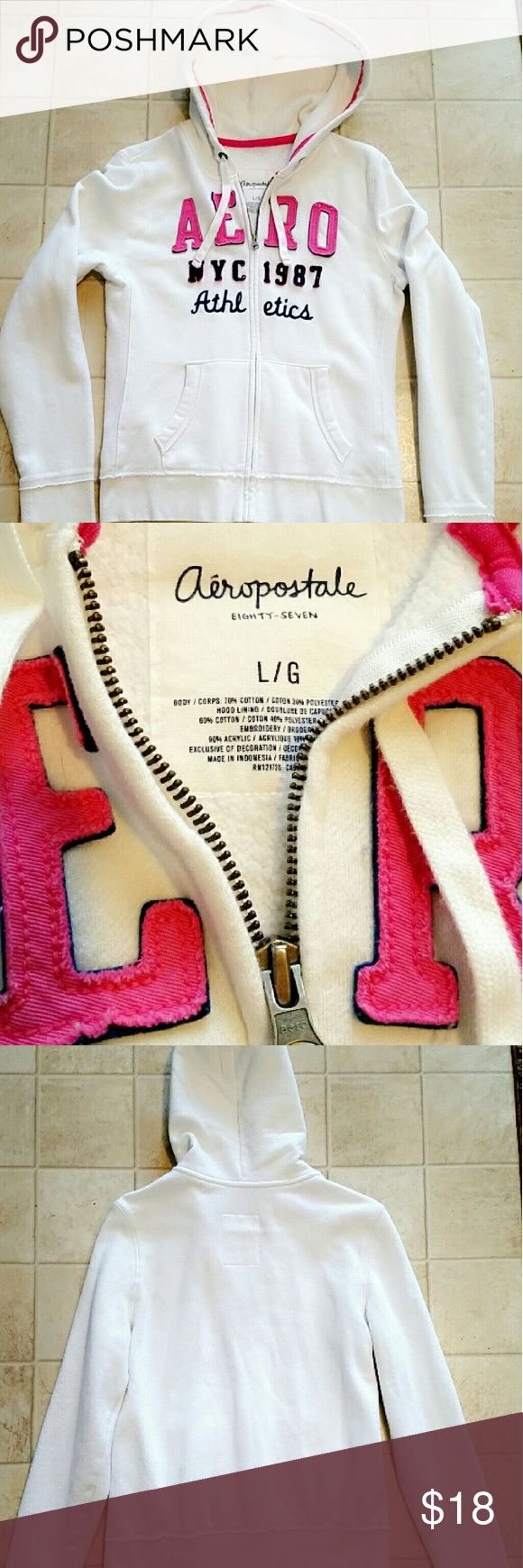 Aeropostale White zip up hoodie with pink Aeropostale White zip up hoodie with pink lettering. Great condition. Size L Aeropostale Tops Sweatshirts & Hoodies