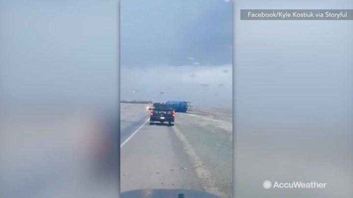 A windstorm lashed parts of Alberta, Canada, on October 18, with winds up to 80 mph. Power was out in several areas and several semi-truck rollovers and two train derailments were reported. In this video a silo can be seen rolling across a highway.