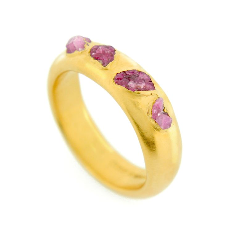 This rough ruby ring is luxurious, boasting an unusual setting for the stone. £210 #unusual #designer #gemstone #rings #London #NudeJewellery