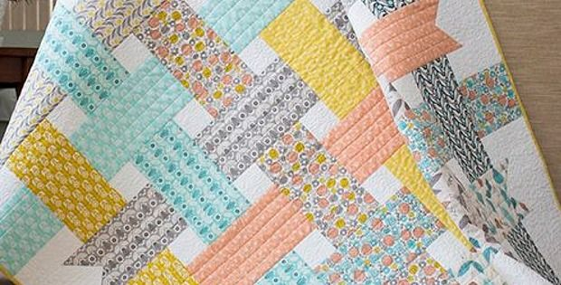 "Great Project for Beginning Quilters! Sometimes you find a quilt design that is so simple yet stunningly effective that you're a bit awed by it. That was the case when we saw the ""Ribbon Box Quilt"" by Michelle Engel Bencsko from Make It Sew Projects. We love the soft colors and patchwork feel of this …"