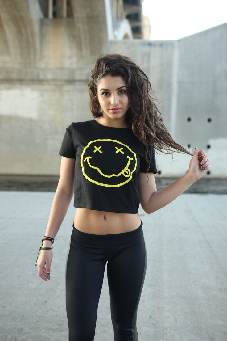 Yellow grunge smiley face graphic design on a black crop top style. All of our crop tops are silk screened for the highest quality possible.