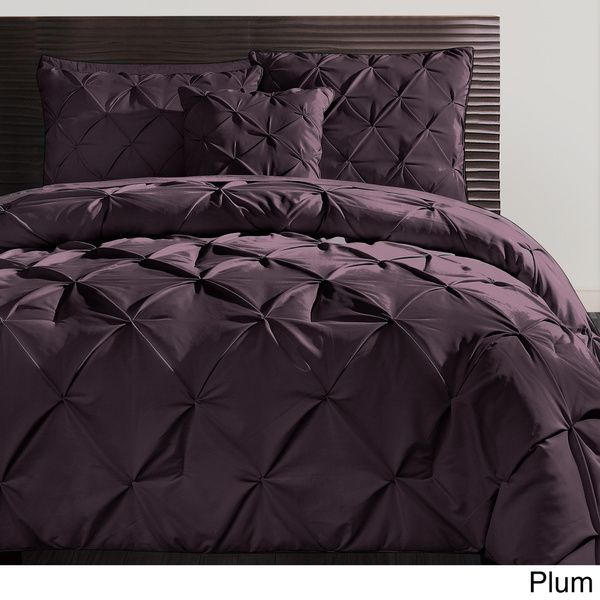 Update your bedroom with contemporary style when you add this soft polyester comforter set from Carmen. Geometric folds complement the buttonless tufting pattern to add depth and character to this set