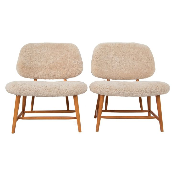 pair of lounge chairs in sheep skin by alf svensson