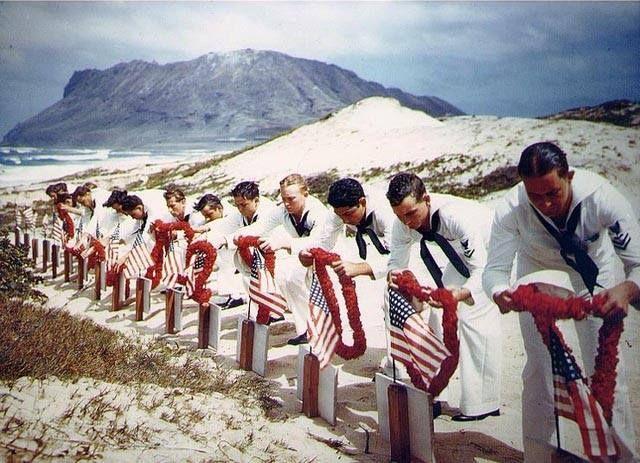 US Navy sailors honoring fellow sailors killed during the Pearl Harbor attack Naval Air Station Kaneohe Oahu US Territory of Hawaii possibly 31 May 1942.