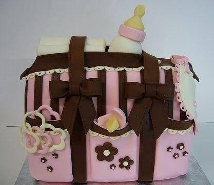 Pink diaper bag baby shower cake for girl.