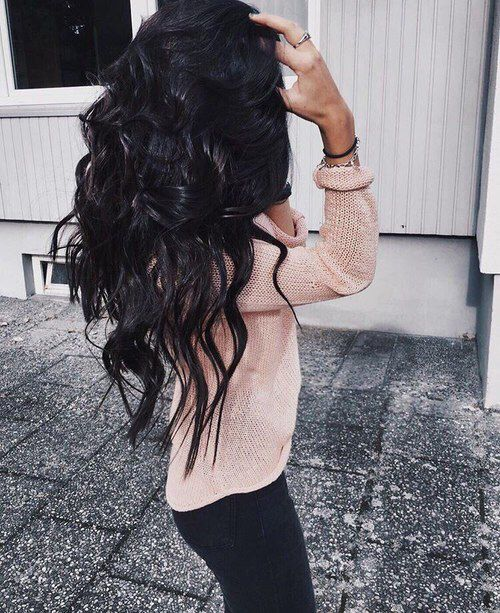 Jet black voluminous curly hair