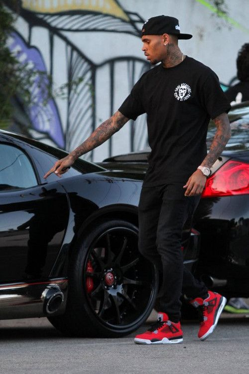 Chris Brown wearing Air Jordan Red Toro's. Check out my sneaker board also. #sneakers #fashion #mens