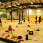 Looking for new indoor activities for Seattle kids? How about taking kids to the beach? Lil' Diggers Time at Sandbox Sports lets children play with balls, slides, shovels, pails and trucks on their indoor beach volleyball court.