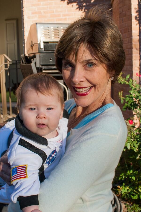 The first-baby-in-space trick or treats with this darling. . .Jenna's baby Mila with grandma Laura Bush. . .Laura looks great!