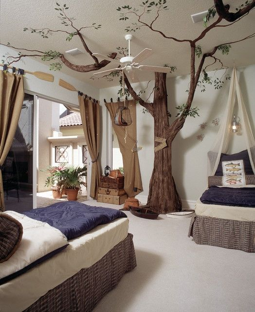 Eclectic Kids Bedroom with Tree Sculpture, Ceiling fan, Carpet, Wall sconce, Built-in bookshelf