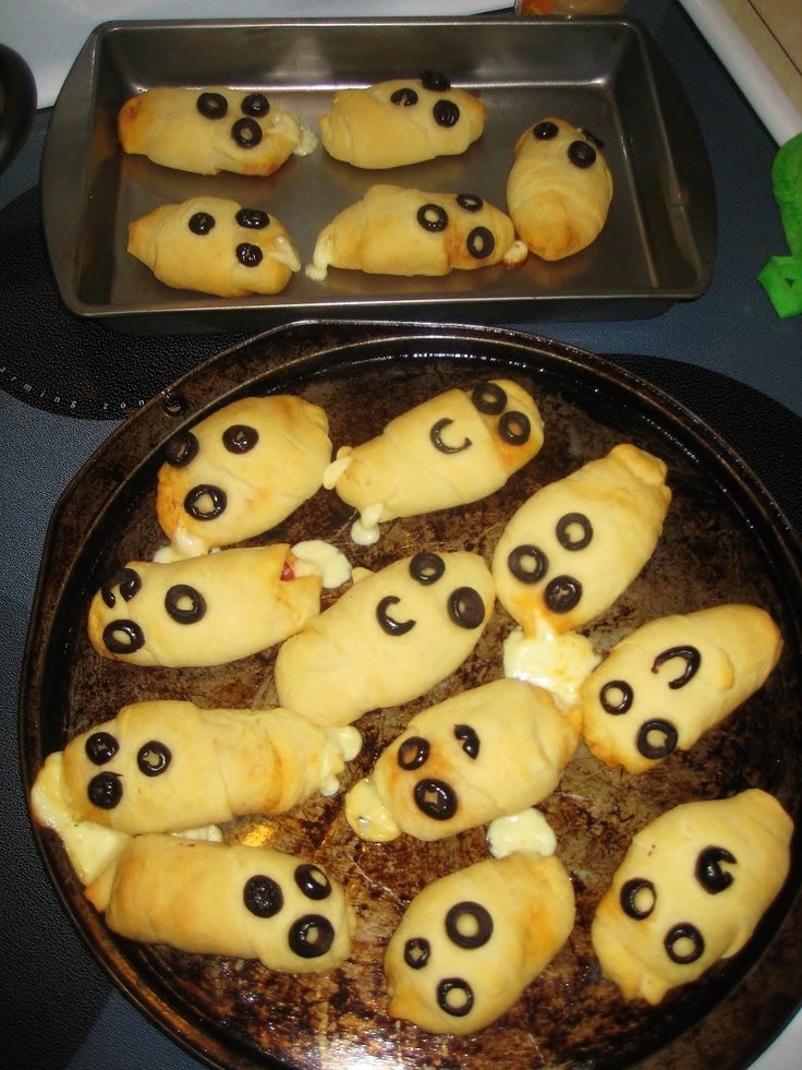 Ghostly pepperoni rolls - crescent roll dough (out of the tube from the grocery store...its easier), pepperoni & string cheese (mozzarella). Lay out dough, add your preferred amount of 'toppings' and roll it all up. Squeeze the ends closed and place sliced black olives on top for the ghost eyes & mouth. Bake for 25ish minutes at 350 and enjoy with marinara sauce for dipping! So tasty, easy & cute.
