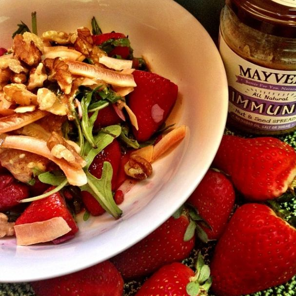 Strawberry nut and seed power packed #salad! #Strawberries, #pomegranate #seeds, rocket, #almond flakes, #Mayver's #Immune #Chia+ Spread, roasted #coconut flakes, juice of half a blood orange for a bit of zing and sprinkled with #walnuts #purestate devine!