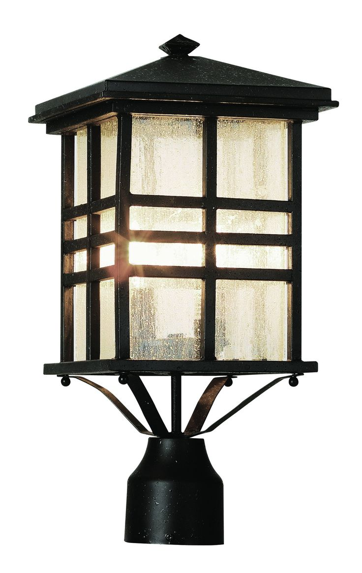 Rustic mission style outdoor post topper perfect for rustic cabin décor. Clear seeded glass in three bar frame. Finish: Black Height: 16'' Width: 8.5'' Depth: 8.5'' Bulb: 2-Candelabra - E12 Wattage: 6