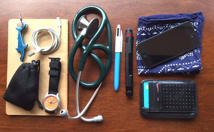 Broke Family Medicine Intern's EDC submitted by R Virchow Velez Porta Tarjetas para Hombre - Black Moleskin Plain Cahier Journals - Kraft Brown - Large Vintage Handkerchief TaoTronics Bluetooth In-Ear-Headset 3M Littmann Cardiology III Stethoscope Coast G20 BIC 4-Color Ball Pen Medium Point Shark Shaped Pendant Keyring Bottle Opener Apple iPhone 5 Seiko 7S26B Apple Lightning to USB EDC for an outpatient family medicine clinic. Less than what I carry on the inpatient service because