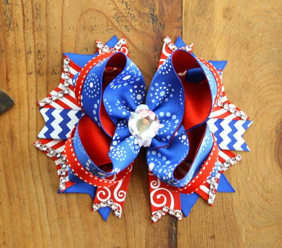 This is an Extra Large Hair Bow Red, Blue and White made with 1.5 in Grosgrain Ribbon. It measures 6 inches across from spike to spike and is