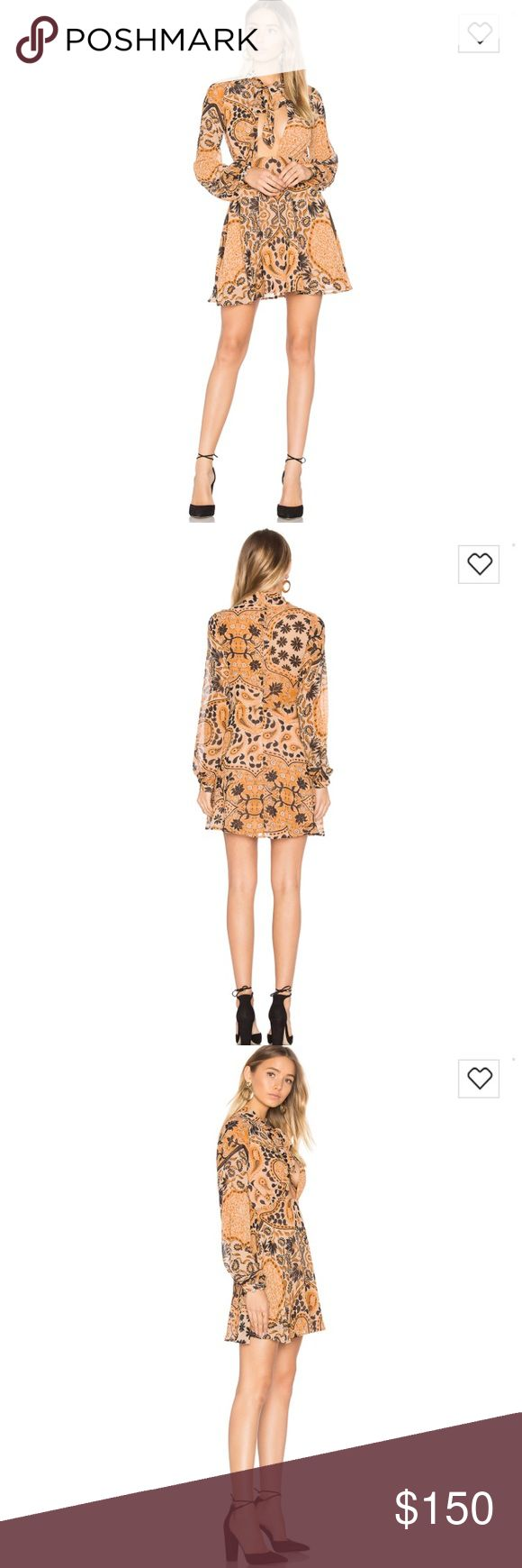 For Love and Lemons Elodi mini dress. Size M. NWT For Love and Lemons dress. Size M. NWT. Love this dress. Bought and having second thoughts about the low cut top. Still for sale on their website for $230.00 For Love and Lemons Dresses