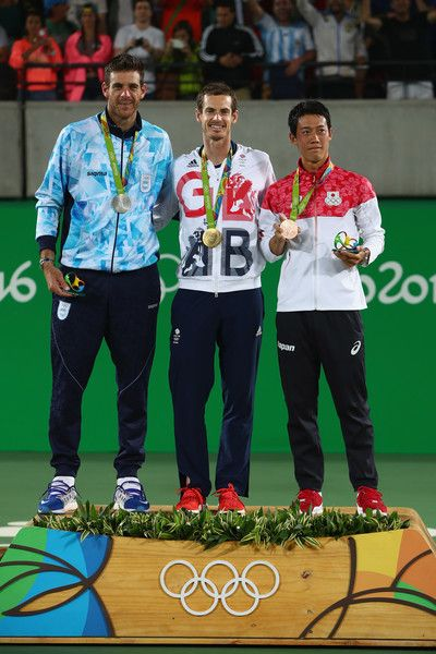(L-R) Silver medalist Juan Martin Del Potro of Argentina, gold medalist Andy Murray of Great Britain and bronze medalist Kei Nishikori of Japan pose during the medal ceremony for the men's singles on Day 9 of the Rio 2016 Olympic Games at the Olympic Tennis Centre on August 14, 2016 in Rio de Janeiro, Brazil.
