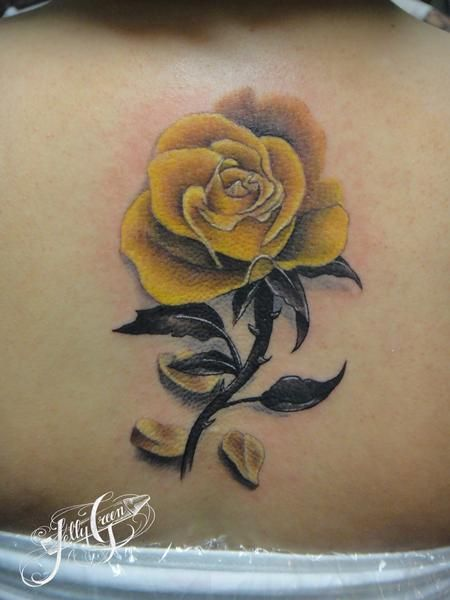 Looking for unique Kelly Green Tattoos?  yellow rose