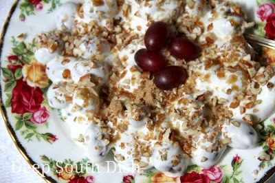 Grape Salad - An old fashioned heirloom fruit salad recipe, made with whole seedless grapes dressed with a sour cream and cream cheese dressing, whipped cream folded in and finished with a brown sugar and pecan topping.